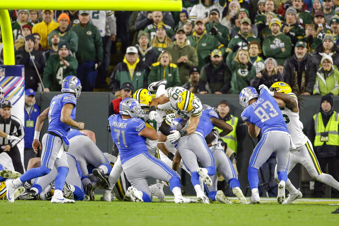 Detroit Lions running back Kerryon Johnson, third from right, rushes for a touchdown during the first half of an NFL football game against the Green Bay Packers, Monday, Oct. 14, 2019, in Green Bay, Wis. (AP Photo/Jeffrey Phelps)