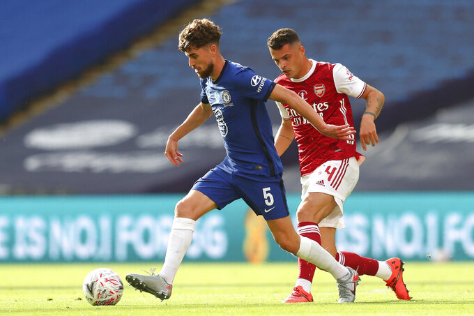 Chelsea's Jorginho challenges for the ball with Arsenal's Granit Xhaka, right, during the FA Cup final soccer match between Arsenal and Chelsea at Wembley stadium in London, England, Saturday, Aug.1, 2020. (Catherine Ivill/Pool via AP)