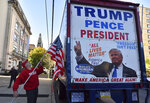 Larry LoSchiavo Jr.of Mt. Poconos hoists an American flag onto a tractor trailer during a small protest outside of a Joe Biden speech in Scranton, Pa., Wednesday, Oct. 23, 2019. (Aimee Dilger/The Times Leader via AP)