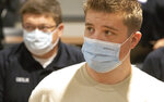 Michael Wells-Whitworth, right, a paramedic from Texas arrives with nearly three dozen healthcare workers from around the country to help supplement the staff at Our Lady of the Lake Regional Medical Center in Baton Rouge, La., Monday, Aug. 2, 2021.  Louisiana has one of the lowest coronavirus vaccination rates in the nation and is seeing one of the country's worst COVID-19 spikes.  (AP Photo/Ted Jackson)