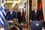 Greek Foreign Minister Nikos Dendias, left, makes a statement with the Albanian Prime Minister Edi Rama in Tirana, Tuesday, Oct. 20, 2020. Bilateral issues and maritime border delimitation in the Ionian Sea were the main topics of their discussion. (AP Photo/Hektor Pustina)