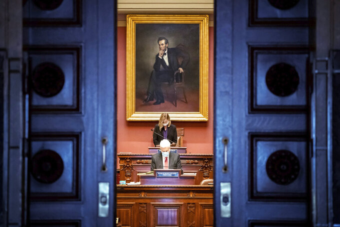 Democratic House Speaker Melissa Hortman, of Brooklyn Park calls for members to stand in silence and bow their heads for 8 Minutes and 46 seconds in honor of George Floyd Friday, June 12, 2020, as the Minnesota State Legislature met in a special session. (Glen Stubbe/Star Tribune via AP)