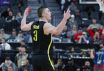 Oregon's Payton Pritchard (3) celebrates after scoring against Utah during the second half of an NCAA college basketball game in the quarterfinals of the Pac-12 men's tournament Thursday, March 14, 2019, in Las Vegas. (AP Photo/John Locher)
