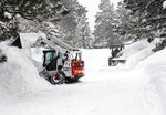 Snow-throwers and front-end loaders are move snow in the Durango West II Subdivision west of Durango, Colo., Friday, Feb. 22, 2019. Schools across northern Arizona, southern Nevada and southwestern Colorado were closed — many for a second day — because of threats posed by snow-packed or slick roads. (Jerry McBride/The Durango Herald via AP)