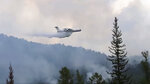 This image taken from video provided by Russian Emergency Ministry, shows a Russian Emergency Ministry multipurpose amphibious aircraft releasing water to extinguish the fire in the Trans-Baikal National Park in Buryatia, southern Siberia, Russia, Thursday, July 9, 2020. About 910 hectares of forest were alight over this area of the Russia's region, according to the ministry of emergency situations. (Russian Emergency Ministry Press Service via AP)