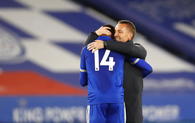 Leicester City manager Brendan Rodgers, right, with Leicester's Kelechi Iheanacho after the English Premier League soccer match between Leicester City and Crystal Palace at the King Power Stadium in Leicester, England, Monday, April 26, 2021. (Andrew Boyers/Pool via AP)