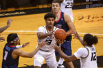 Missouri's Mark Smith, center, pulls in a rebound between Liberty's Chris Parker, left, and Dru Smith, right, during the first half of an NCAA college basketball game Wednesday, Dec. 9, 2020, in Columbia, Mo. (AP Photo/L.G. Patterson)