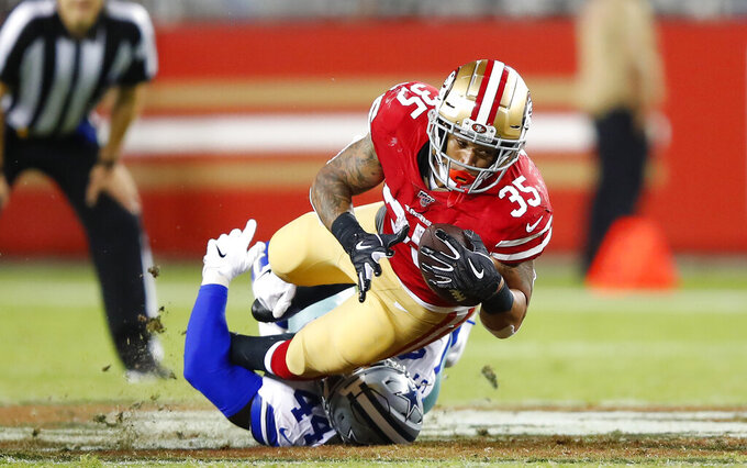 San Francisco 49ers' Brandon Wilds is tackled by Dallas Cowboys' Justin Phillips during the second half of an NFL preseason football game in Santa Clara, Calif., Saturday, Aug. 10, 2019. (AP Photo/John Hefti)