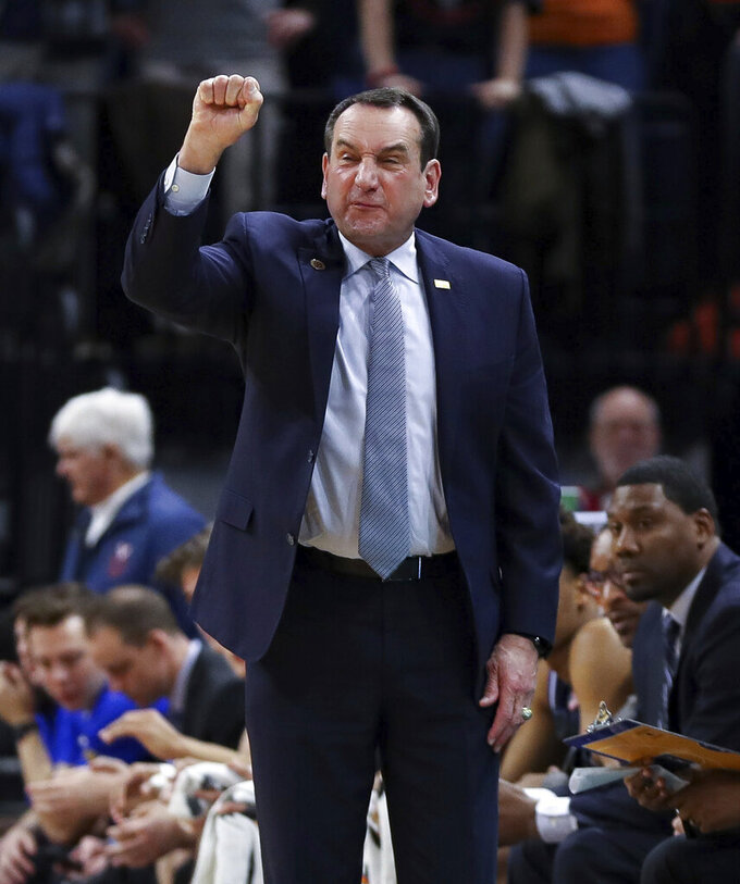 Duke head coach Mike Krzyzewski calls a play during an NCAA college basketball game against Virginia  Saturday, Feb. 29, 2020, in Charlottesville, Va. (AP Photo/Andrew Shurtleff)