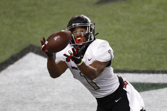 UNLV wide receiver Kyle Williams pulls in a touchdown pass during the first half of the team's NCAA college football game against Hawaii on Saturday, Dec. 12, 2020, in Honolulu. (AP Photo/Marco Garcia)