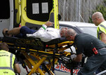 Ambulance staff take a man from outside a mosque in central Christchurch, New Zealand, Friday, March 15, 2019, following a mass shooting. (AP Photo/Mark Baker)