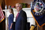 FILE - In this Tuesday, Sept. 29, 2020 file photo, Senate Majority Leader Mitch McConnell of Ky., meets with Supreme Court nominee Judge Amy Coney Barrett on Capitol Hill in Washington. (AP Photo/Susan Walsh, POOL)