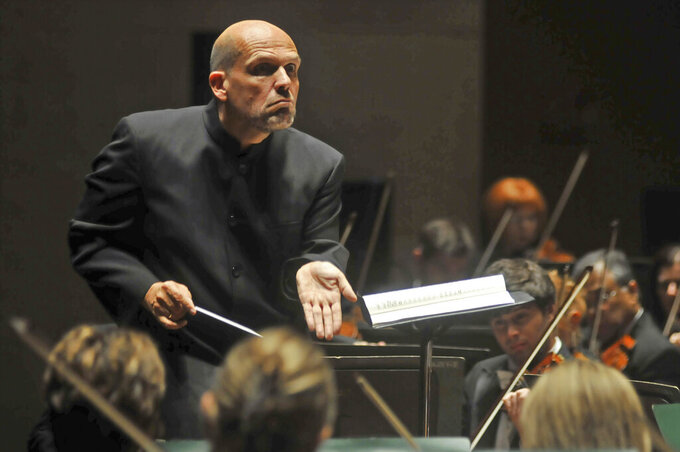 FILE - In this Sept. 29, 2011, file photo, Jaap van Zweden conducts the Dallas Symphony Orchestra in Dallas. Van Zweden will leave the New York Philharmonic at the end of the 2023-24 season after six years as music director, the shortest tenure of anyone in a half-century. Van Zweden informed the orchestra at the end of a rehearsal Wednesday, Sept. 15, 2021, two days before the orchestra resumes performances after an 18-month stoppage. (Mark M. Hancock/The Dallas Morning News via AP, File)