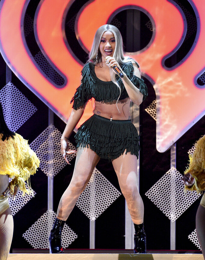 "FILE - In this Dec. 7, 2018 file photo, hip-hop recording artist Cardi B performs at Z100's iHeartRadio Jingle Ball at Madison Square Garden in New York. Cardi B says she received an offer to perform at the Super Bowl, but struggled with the decision to turn down the lucrative opportunity in support of ex-NFL player Colin Kaepernick. The Grammy-nominated rapper told The Associated Press on Friday, Feb. 1, 2019, that she had ""mixed feelings"" after she declined to take the stage at Super Bowl 53 in Atlanta. (Photo by Evan Agostini/Invision/AP, File)"