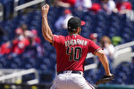 Arizona Diamondbacks starting pitcher Madison Bumgarner throws during the fifth inning of a baseball game against the Washington Nationals at Nationals Park, Sunday, April 18, 2021, in Washington. (AP Photo/Alex Brandon)