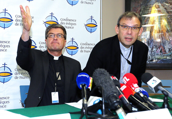 French bishops Eric de Moulins Beaufort, left, and Dominique Blanchet attend a press conference in Lourdes, southwestern France, Saturday, Nov. 9, 2019. 120 bishops are convening for their biannual assembly in Lourdes, where they will discuss the plan for a