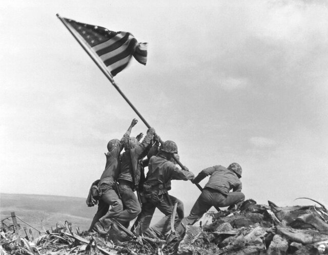 FILE - In this Feb. 23, 1945, file photo, U.S. Marines of the 28th Regiment, 5th Division, raise an American flag atop Mt. Suribachi, Iwo Jima, Japan. Strategically located only 660 miles from Tokyo, the Pacific island became the site of one of the bloodiest, most famous battles of World War II against Japan. The bombs stopped falling 75 years ago, but it is entirely possible - crucial even, some argue - to view the region's world-beating economies, its massive cultural and political reach and its bitter trade, territory and history disputes all through a single prism: Japan's aggression in the Pacific during World War II. (AP Photo/Joe Rosenthal, File)