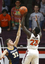 Virginia Tech's Tyrece Radford (23) shoots over Chattanooga's Matt Ryan (32) in the first half of an NCAA college basketball game, Wednesday, Dec. 11, 2019, in Blacksburg, Va. (Matt Gentry/The Roanoke Times via AP)
