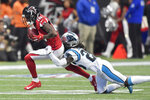 Carolina Panthers strong safety Eric Reid (25) hits Atlanta Falcons wide receiver Calvin Ridley (18) during the first half of an NFL football game, Sunday, Dec. 8, 2019, in Atlanta. (AP Photo/Mike Stewart)