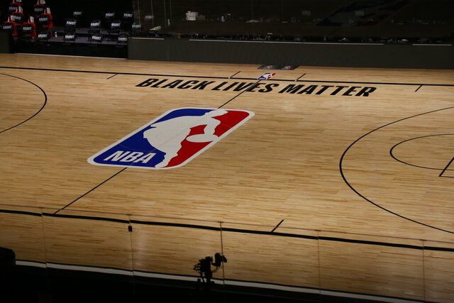 A general view inside The Field House before Game 5 of an NBA basketball first-round playoff series, between the Oklahoma City Thunder and Houston Rockets, Wednesday, Aug. 26, 2020, in Lake Buena Vista, Fla. NBA players made their strongest statement yet against racial injustice Wednesday when the Milwaukee Bucks didn't take the floor for their playoff game against the Orlando Magic. (Kim Klement/Pool Photo via AP)