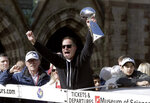 New England Patriots offensive coordinator Josh McDaniels lifts the trophy as the team parades through downtown Boston, Tuesday, Feb. 5, 2019, to celebrate their win over the Los Angeles Rams in Sunday's NFL Super Bowl 53 football game in Atlanta. (AP Photo/Steven Senne)