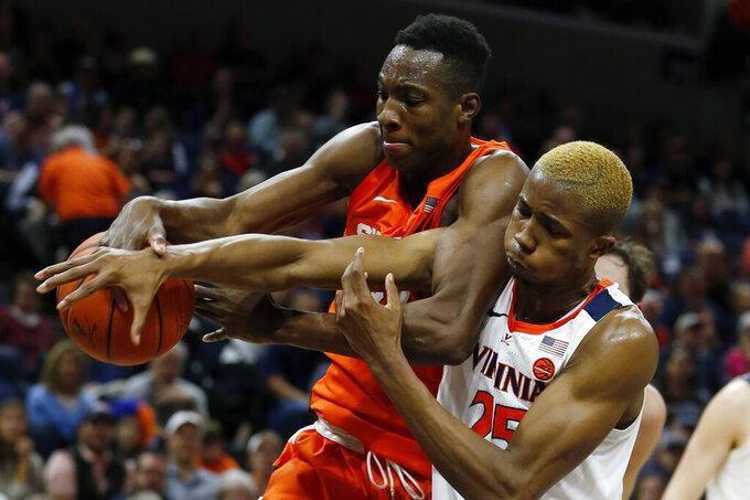 Syracuse forward Bourama Sidibe (34) and Virginia forward Mamadi Diakite (25) battle for a rebound during the first half of an NCAA college basketball game in Charlottesville, Va., Saturday, Jan. 11, 2020. (AP Photo/Steve Helber)