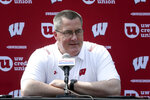 """FILE - Wisconsin head football coach Paul Chryst talks to reporters during the team's NCAA college football media day at Camp Randall Stadium in Madison, Wis., in this Thursday, Aug. 5, 2021, file photo. There will be no easing into the season for most Big Ten teams. """"What a way to open up this season,"""" said Wisconsin coach Paul Chryst, whose 12th-ranked team hosts No. 19 Penn State on Saturday, Sept. 4. (Kayla Wolf/Wisconsin State Journal via AP, File)"""
