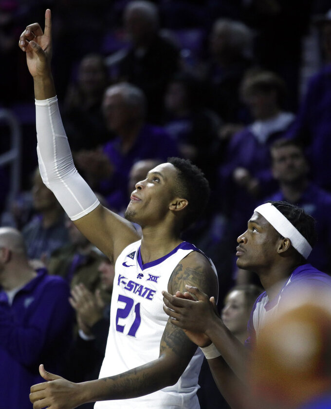 Kansas State forwards James Love III (21) and Austin Trice, right, celebrate a basket during the second half of the team's NCAA college basketball game against West Virginia in Manhattan, Kan., Wednesday, Jan. 9, 2019. (AP Photo/Orlin Wagner)