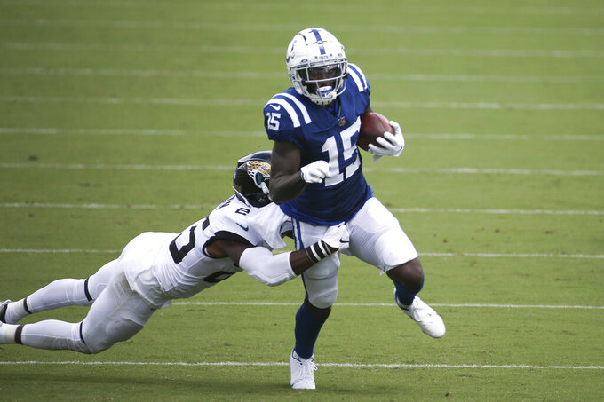 Indianapolis Colts wide receiver Parris Campbell (15) tries to escape a tackle by Jacksonville Jaguars cornerback D.J. Hayden, left, during the first half of an NFL football game, Sunday, Sept. 13, 2020, in Jacksonville, Fla. (AP Photo/Stephen B. Morton)