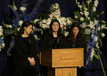 Jackie Corona, center, speaks between her sisters during funeral services for their sister, Davis Police Officer Natalie Corona, at the University of California, Davis, Friday, Jan. 18, 2019, in Davis, Calif. Corona was was shot and killed Jan. 10, responding to scene of a three-car crash in Davis. Police say gunman Kevin Douglas Limbaugh, 48, not involved in the crash, rode up on a bicycle and without warning, opened fire on Corona. (AP Photo/Rich Pedroncelli, pool)
