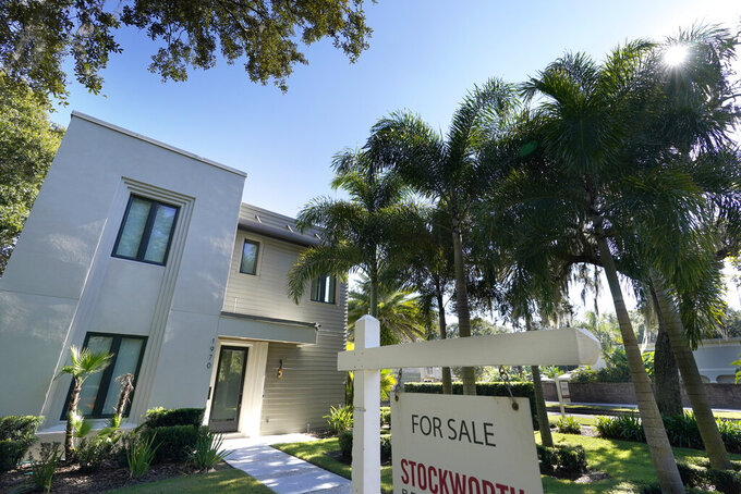 In this A home for sale is seen Tuesday, Dec. 8, 2020, in Orlando, Fla.  U.S. long-term mortgage rates were steady to higher this week, Thursday, March 4, 2021, as the benchmark 30-year loan breached the 3% mark for the first time since July 2020.   (AP Photo/John Raoux)