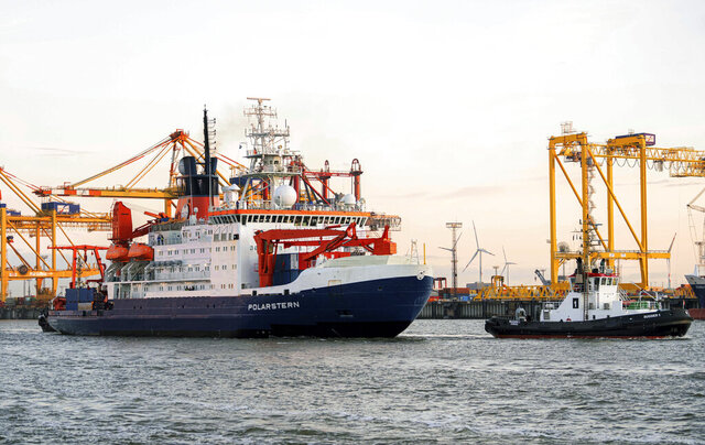 The research vessel 'Polarstern' returns to Bremerhaven, Germany, Monday, Oct. 12, 2020. The icebreaker, carrying scientists on a year-long international effort to study the high Arctic, has returned to its home port in Germany. (Mohssen Assanimoghaddam/dpa via AP)