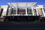 The exterior view of Capital One Arena is seen, Saturday, March 16, 2019, in Washington.  As NCAA prepares to stage its first basketball championships since the Supreme Court allowed legal sports betting in any state that wants it, the organization remains opposed to gambling on its events. But it's not denying reality, either.  This year, at least one and likely two women's games will be played in Mississippi, where people have been betting on college sports since last summer, and men's games will be played in Washington at Capital One Arena, which could have a full-service onsite sports book this time next year. Future NCAA Tournament games are scheduled for Wells Fargo Center, an 11-mile drive from the sports book at Harrah's Philadelphia.  (AP Photo/Nick Wass)(AP Photo/Nick Wass)
