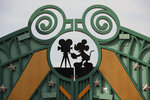 FILE - In this Sunday, June 8, 2018 file photo, a Mickey Mouse sign is displayed on the gate of the first Avengers-themed entrance at Disneyland Paris, in Chessy, France, east of Paris. The French tourist industry received a further boost Wednesday, July 15, 2020 with the partial reopening of Disneyland Paris and the opening up of the top floor of the Eiffel Tower. Disneyland Paris, Europe's most frequented theme park resort, is partially re-opening to the public, four months after it closed as a result of the coronavirus pandemic. (AP Photo/Francois Mori, File)