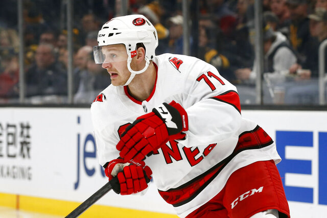 FILE - In this Dec. 3, 2019, file photo, Carolina Hurricanes' Lucas Wallmark plays against the Boston Bruins during an NHL hockey game in Boston. The Florida Panthers traded Vincent Trocheck to the Carolina Hurricanes for Erik Haula, Lucas Wallmark and prospects Chase Priskie and Eetu Luostarinen, Monday, Feb. 24, 2020.  (AP Photo/Michael Dwyer, File)