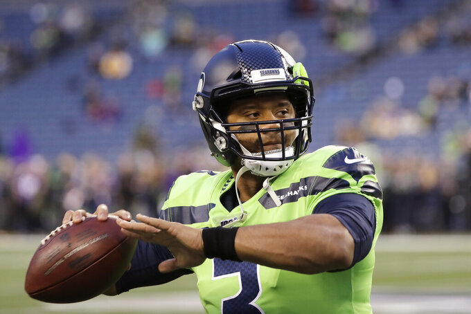 Seattle Seahawks quarterback Russell Wilson warms up before an NFL football game against the Minnesota Vikings, Monday, Dec. 2, 2019, in Seattle. (AP Photo/Ted S. Warren)