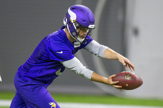 FILE - In this June 11, 2019, file photo, then-Minnesota Vikings punter Matt Wile punts during drills at the team's NFL football training facility in Eagan, Minn. The Atlanta Falcons have a new backup plan if punter Matt Bosher hasn't recovered from a groin injury by Sunday's game at Indianapolis. Matt Wile worked on punts and kickoffs on Wednesday, Sept. 18, 20919, one day after he was signed to the practice squad. Wile was Minnesota's punter in 2018, and he spent time with the Falcons in 2016. (AP Photo/Andy Clayton- King, File)