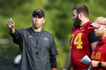FILE - In this Aug. 2, 2019, file photo, Iowa State coach Matt Campbell, left, talks with offensive lineman Bryce Meeker (74) during an NCAA college football practice, in Ames, Iowa. (AP Photo/Charlie Neibergall, File)