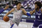 Kansas forward Jalen Wilson (10) drives against TCU guard PJ Fuller (4) during the first half of an NCAA college basketball game in Fort Worth, Texas, Tuesday, Jan. 5, 2021. (AP Photo/Ron Jenkins)