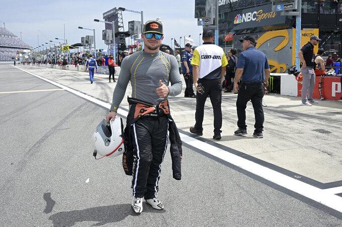 Driver Mason Massey walks to his vehicle on pit road before a NASCAR Xfinity Series auto race at Daytona International Speedway, Saturday, Aug. 28, 2021, in Daytona Beach, Fla. (AP Photo/Phelan M. Ebenhack)