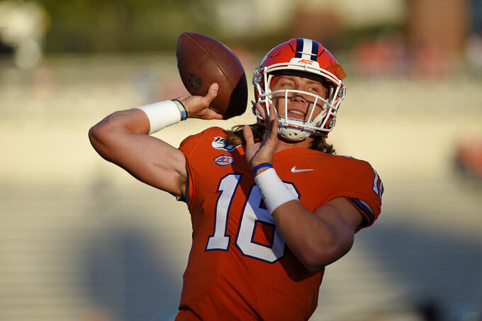 Clemson quarterback Trevor Lawrence warms up for the team's NCAA college football game against Charlotte on Saturday, Sept. 21, 2019, in Clemson, S.C. (AP Photo/Richard Shiro)