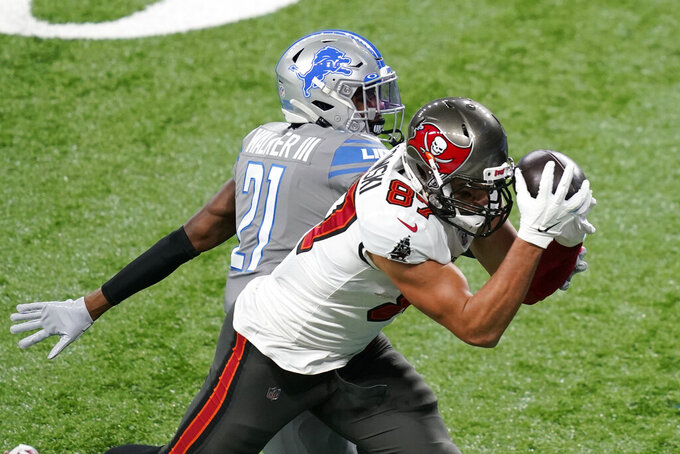 Tampa Bay Buccaneers tight end Rob Gronkowski (87), defended by Detroit Lions defensive back Tracy Walker (21), catches a 33-yard pass for a touchdown during the first half of an NFL football game, Saturday, Dec. 26, 2020, in Detroit. (AP Photo/Carlos Osorio)