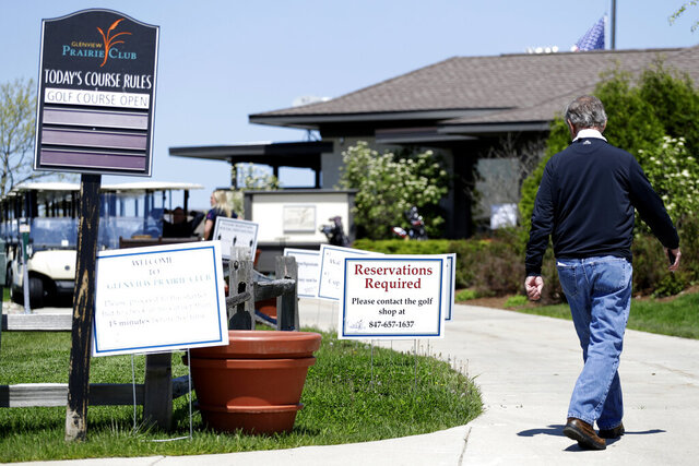 Signs are displayed at the Glenview Prairie Club in Glenview, Ill., Thursday, May 21, 2020. All state parks haven't already reopened will be allowed to do on boating, golf to ease in Phase Three of restore Illinois plan on May 29. For golfers, Phase Three will also usher in the return of foursomes on golf courses, as up to four golfers will be allowed to play in the same group. Previously only two golfers had been allowed to play. Golf carts can also be used by one person only. (AP Photo/Nam Y. Huh)