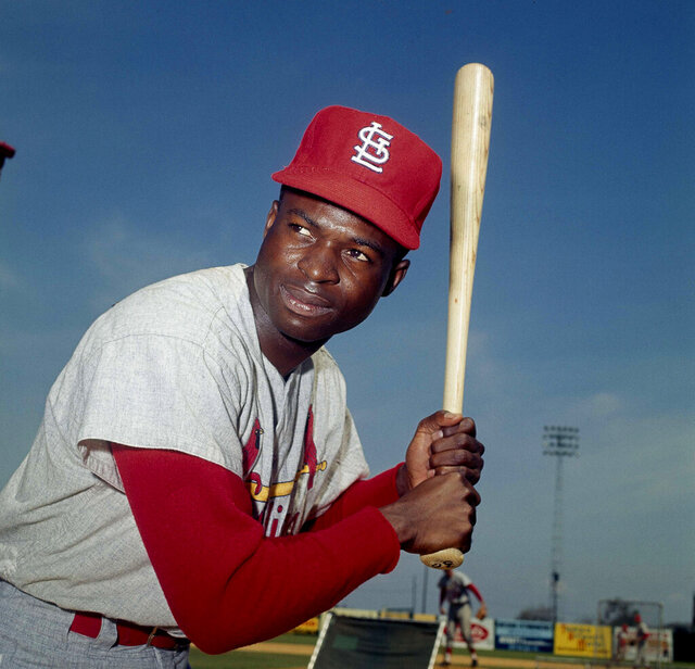 FILE - In this April 9, 1965, file photo, Lou Brock, of the St. Louis Cardinals, poses in Missouri. Hall of Famer Brock, one of baseball's signature leadoff hitters and base stealers who helped the Cardinals win three pennants and two World Series titles in the 1960s, has died. He was 81. (AP Photo, File)