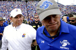 Kansas head coach Les Miles, left, and Indiana State head coach Curt Mallory part ways after shaking hands following their NCAA college football game Saturday, Aug. 31, 2019, in Lawrence, Kan. Kansas won 24-17. (AP Photo/Charlie Riedel)