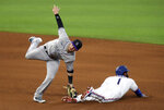 Colorado Rockies shortstop Trevor Story (27) makes the tag on Texas Rangers' Elvis Andrus (1) who was attempting to steal in the fourth inning of a baseball game Saturday, July 25, 2020, in Arlington, Texas. (AP Photo/Richard W. Rodriguez)