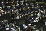Lawmakers attend an open session of parliament to debate the proposed ministers of President Ebrahim Raisi's new cabinet, in Tehran, Iran, Wednesday, Aug. 25, 2021. Iran's hard-liner dominated parliament Wednesday voted to approve most of the proposed ministers by the recently elected president. (AP Photo/Vahid Salemi)