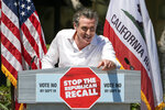 California Gov. Gavin Newsom campaigns against the recall election at Culver City High School in Culver City, Calif., Saturday, Sept. 4, 2021. (AP Photo/Damian Dovarganes)