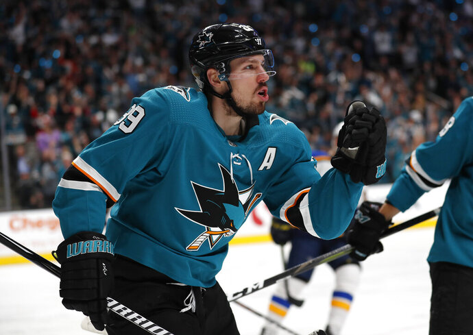 San Jose Sharks' Logan Couture (39) celebrates after scoring a goal against the St. Louis Blues in the first period in Game 1 of the NHL hockey Stanley Cup Western Conference finals in San Jose, Calif., on Saturday, May 11, 2019. (AP Photo/Josie Lepe)