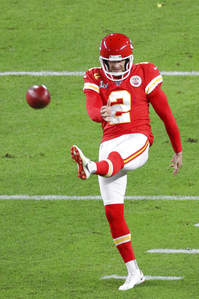 Kansas City Chiefs punter Dustin Colquitt (2) punts the ball during the NFL Super Bowl football game against the San Francisco 49ers, Sunday, Feb. 2, 2020 in Miami Gardens, Fla. The Chiefs defeated the 49ers 31-20.(Margaret Bowles via AP)
